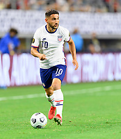 DALLAS, TX - JULY 25: Cristian Roldan #10 of the United States looks to pass the ball during a game between Jamaica and USMNT at AT&T Stadium on July 25, 2021 in Dallas, Texas.
