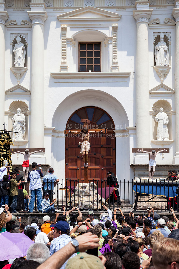 Antigua, Guatemala.  Effigies of Jesus Crucified with the Two Thieves, in front of San Jose Cathedral, Semana Santa, Good Friday.