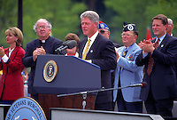 Bill Clinton speaks at the dedication of the Korean War Veterans Monument as V.P. Al Gore looks on. Washington, DC, August 1995. President Bill Clinton & V.P. Al Gore. Washington DC USA.