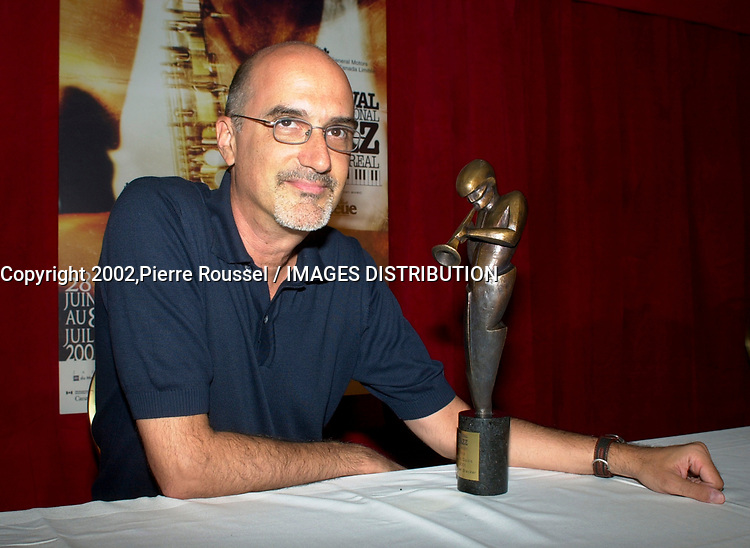 Montreal, June 28th 2001<br /><br />American Jazz musician Michael Brecker pose for photographers with  the 8th Miles-Davis Awardthat he received  from the Montreal Jazz Festibal, June 28th 2001.<br /><br />This award highlight the entire work of a Jazz artist  and his contribution to the renewal of the form.<br />Breckeralready  won 2 grammys awards in 1997 and has played with many musicians including Paul Simon, Herbie Hancock, Pat Metheny and Bruce Springsteen as well as his brother Randy with whom he founded the Brecker Brother in the70's<br /><br /><br /><br />(Photo : (c) 2001, Pierre Roussel<br />NOTE :  Nikon D-1 JPEG, opened with QUIMAGE ICC profile, saved as Adobe RG 1998