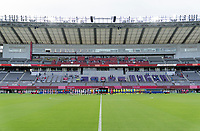 TOKYO, JAPAN - JULY 21: The USWNT and Sweden stand for anthems at Tokyo Stadium before a game between Sweden and USWNT at Tokyo Stadium on July 21, 2021 in Tokyo, Japan.