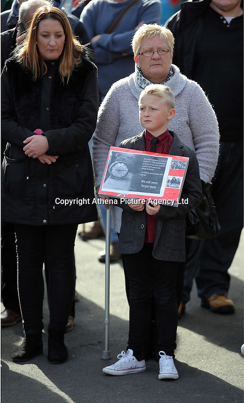 Pictured: A young boy with an album with pictures from the time joins other members of public gather to see Prince Charles at the Memorial Garden in Aberfan Friday 21 October 2016<br />Re: Wales has fallen silent as the country remembered the Aberfan disaster 50 years ago.<br />On 21 October 1966, a mountain of coal waste slid down into a school and houses in the Welsh village, killing 144 people, including 116 children.<br />A day of events to commemorate the disaster included a service at Aberfan Cemetery at 9:15am on Friday.<br />Prince Charles is visiting Aberfan memorial garden before unveiling a plaque in memory of the victims.<br />He will also attend a reception with the families of some of those who lost their lives, before signing a book of remembrance.