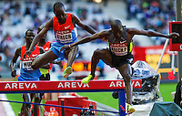 06 JUL 2012 - PARIS, FRA - Paul Koech of Kenya clears a hurdle ahead of Jairus Birech of Ethiopia during the men's 3000m Steeplechase race during the 2012 Meeting Areva held in the Stade de France in Paris, France (PHOTO (C) 2012 NIGEL FARROW)