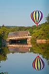A hot air balloon reflected in the Ottaquechee River in Quechee village, Hartford, VT, USA