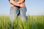 Russia, Voronezh, couple embracing in field
