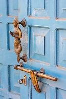 Bhaktapur, Nepal.  Door Handle Showing the Namaste Gesture of Greeting.