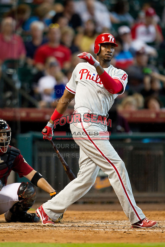 Philadelphia Phillies outfielder Domonic Brown #9 swings during the Major League baseball game against the Houston Astros on September 16th, 2012 at Minute Maid Park in Houston, Texas. The Astros defeated the Phillies 7-6. (Andrew Woolley/Four Seam Images)..