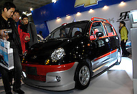 Visitors view a Chevrolet Spark at Beijing International Automobil Exhibition in Beijing, China..19 Nov 2006