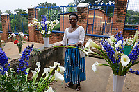 RWANDA, Kigali, Gikondo, Centre St. Vincent Pallotti, woman cuts flowers for marriage