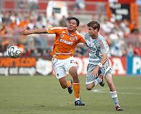 Houston Dynamo forward Brian Ching (25) passes away from FC Dallas defender Drew Moor (14).  Houston Dynamo beat FC Dallas 2-1 at Robertson Stadium in Houston, TX on June 3, 2007.