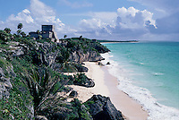 "The Castle,"""" Tulum, Mayan ruins on rocks above a white-sand beach with turquoise water. Quintana Roo, Mexico."