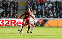 Saturday 2nd March 2013<br /> Pictured: (R-L) Angel Rangel, Yoan Gouffran.<br /> Re: Barclays Premier Leaguel, Swansea  v Newcastle at the Liberty Stadium in Swansea.