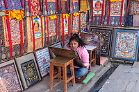 Nepal, Changu Narayan.  Student Artist Painting Thangka Paintings in Art Shop.