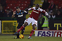 Peter Hartley of Stevenage tackles Dany N'Guessan of Swindon<br />  - Swindon Town v Stevenage - Johnstone's Paint Trophy - Southern Section Semi-final  - County Ground, Swindon - 10th December, 2013<br />  © Kevin Coleman 2013