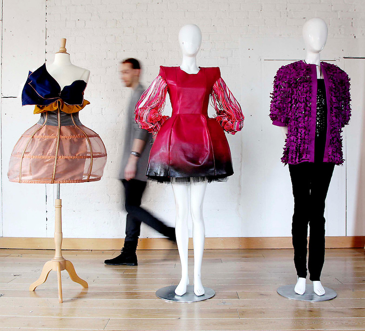 """The three chosen finalist entry garments by runner-up Matthew Karp, from Limerick Senior College entitled """"Butterfly Effect"""" (left) with Overall winning entry, Emmy Slattery, from NCAD entitled """"Knotted (centre) and Niamh Rafferty, from The Grafton Academy entitled """"Encased"""" (right), pictured on display before the announcement of the Nokia Young Fashion Designer Award."""
