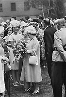 La Reine Mere visite les Blackwatch a Montreal, 1962<br /> <br /> Roses between the raindrops; Queen Mother charmed off the rain long enough for the Black Watch to go ahead with its scheduled garden party yesterday on the lawn of headquarters; Quebec Command in Montreal. 1962<br /> <br /> PHOTO :  Frank Grant - Toronto Star Archives - AQP