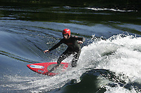 Nestled amongst snowcapped mountains,  and over 100 kilometers from any saltwater, the village of Voss may seem an unlikely spot for surfing. That doesn't stop a group of  of local surfers who has found several spots in rivers nearby...Pa?l Kristian Lindseth was the first to conquer the river Vosso on a surfboard. He now uses a specially made surfboard, wider and shorter than most boards. © Fredrik Naumann