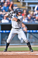 Charleston RiverDogs left fielder Michael O'Neill #10 awaits a pitch during a game against the Asheville Tourists at McCormick Field July 26, 2014 in Asheville, North Carolina. The RiverDogs defeated the Tourists 8-7. (Tony Farlow/Four Seam Images)