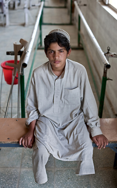 20 August 2011, Kabul, Afghanistan:  Saida Aziz (12) who lost both his legs after a coalition helicopter fired two shells killing 12 of his fathers sheep and the second slicing his legs off before exploding outside Bagram air base where he was herding sheep. He is at the International Committee of the Red Cross (ICRC) Orthopaedic Centre in Kabul where victims of war as well as the disabled, are fitted with artificial limbs, hand made on the compound. Saida is being rehabilitated with new legs. Picture by Graham Crouch for The Australian Magazine