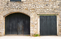 Chateau de Lascaux, Vacquieres village. Pic St Loup. Languedoc. A door. The winery building. France. Europe.