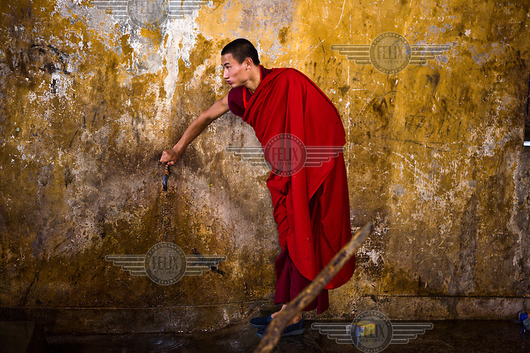 A Buddhist monk is seen inside the kitchen of the ancient Punakha Dzong (fortress) in Punakha, Bhutan.