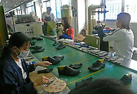 "One of the production lines of the Brilliant Footwear Company Limited in Tangxia, China, which is the factory produces trainers for the ""green"" and ""socially conscious"" company Wornagain..20 Mar 2007"