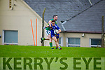 Annascaul's Cathal Ferriter been tackled by Darren O'Cearúil in the West Kerry Senior Championship.