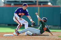 Second Baseman Steve Wilkerson #17 applies the tag on a hard sliding Garrett Kennedy during a  game against the Miami Hurricanes at Doug Kingsmore Stadium on March 31, 2012 in Clemson, South Carolina. The Tigers won the game 3-1. (Tony Farlow/Four Seam Images).