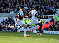 Pictured: Wilfried Bony of Swansea (R) closely followed by James Tomkins (L) of West Ham. 01 February 2014<br /> Re: Barclay's Premier League, West Ham United v Swansea City FC at Boleyn Ground, London.