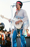 """BNPS.co.uk (01202 558833)<br /> Pic: BarryLevine/Guernseys/BNPS<br /> <br /> !!!ONE TIME USE ONLY!!! PICS ONLY TO BE USED IN RELATION TO THE AUCTION!!!<br /> <br /> Pictured: Jimi Hendrix.<br /> <br /> A photo collection offering a rare glimpse of the iconic Woodstock Festival has sold for over £12,000.<br /> <br /> The unique Levine series captured some of the world's most famous rock stars performing at the one-of-a-kind festival in Bethel, New York, in August 1969, including Jimi Hendrix, Janis Joplin, The Who, and Neil Young.<br /> <br /> Barry Levine, now 77, brushed shoulders with many of his subjects, recalling Hendrix's """"amazing sense of humour"""" and Young's disdain for photographers from his home in Florida."""
