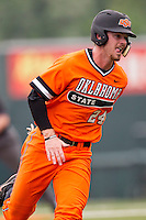Oklahoma State Cowboys outfielder Conor Costello #24 rounds third base during the NCAA baseball game against the Texas Longhorns on April 26, 2014 at UFCU Disch–Falk Field in Austin, Texas. The Cowboys defeated the Longhorns 2-1. (Andrew Woolley/Four Seam Images)