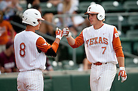 Texas Longhorns shortstop Jordan Etier #7 is greeted by teammate Mark Payton #8 after his ninth inning home run in the NCAA baseball game against the Texas A&M Aggies on April 28, 2012 at UFCU Disch-Falk Field in Austin, Texas. The Aggies beat the Longhorns 12-4. (Andrew Woolley / Four Seam Images).