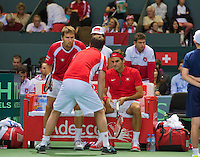 Switserland, Genève, September 19, 2015, Tennis,   Davis Cup, Switserland-Netherlands, Doubles: Swiss team Marco Chiudinelli/Roger Federer (R) in the middle captain Severin Luthi<br /> Photo: Tennisimages/Henk Koster