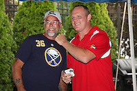 Buffalo Sabres legend Rob Ray signs autographs and poses for photos with fans before a Batavia Muckdogs game against the Auburn Doubledays at Dwyer Stadium on August 27, 2011 in Batavia, New York.  Batavia defeated Auburn 7-5.  (Mike Janes/Four Seam Images)