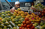A muslim Indian man selling mangoes on a footpath in Kolkata, West Bengal,  India  7/18/2007.  Arindam Mukherjee/Landov