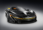 Matte black 2015 McLaren P1 plug-in hybrid supercar isolated sports car on gray background with clipping path Image © MaximImages, License at https://www.maximimages.com