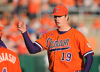 Starting pitcher Kevin Brady (19) of the Clemson Tigers in a game against the University of Alabama-Birmingham on Feb. 17, 2012, at Doug Kingsmore Stadium in Clemson, South Carolina. UAB won 2-1. (Tom Priddy/Four Seam Images)