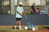 Mooresville Spinners head coach Tripp Hamrick helps prep the field prior to the game against the Dry Pond Blue Sox at Moor Park on July 2, 2020 in Mooresville, NC.  The Spinners defeated the Blue Sox 9-4. (Brian Westerholt/Four Seam Images)