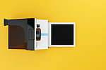 Vintage instant camera with blank frame. Evenly lit computer generated image on a fresh yellow studio background and seen from above. CGI/3D model based on the popular instant camera first introduced in 1977.