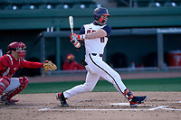 First baseman Kellen Sarver (18) of the Illinois Fighting Illini bats in a game against the Ohio State Buckeyes on Friday, March 5, 2021, at Fluor Field at the West End in Greenville, South Carolina. The Ohio State catcher is Brent Todys. (Tom Priddy/Four Seam Images)