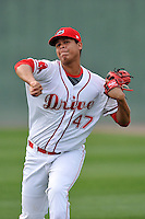 Starting pitcher Daniel Gonzalez (47) of the Greenville Drive delivers a pitch warms up before a game against the Columbia Fireflies on Thursday, April 21, 2016, at Fluor Field at the West End in Greenville, South Carolina. Columbia won, 13-9. (Tom Priddy/Four Seam Images)