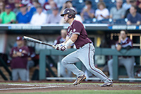 Mississippi State Bulldogs catcher Dustin Skelton (8) follows through on his swing during Game 10 of the NCAA College World Series against the Louisville Cardinals on June 20, 2019 at TD Ameritrade Park in Omaha, Nebraska. Louisville defeated Mississippi State 4-3. (Andrew Woolley/Four Seam Images)
