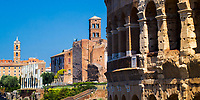 Ancient Roman Colosseum (Flavian Amphitheatre) with the Roman Forum and Sant'Anastasia al Palatino in the background, in Rome Italy, Southern Europe