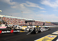 Oct 4, 2013; Mohnton, PA, USA; NHRA top fuel dragster driver Shawn Langdon (near lane) races alongside Doug Kalitta during qualifying for the Auto Plus Nationals at Maple Grove Raceway. Mandatory Credit: Mark J. Rebilas-