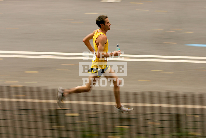 Josh Rohatinsky runs through Central Park while competing in the 2008 Men's Olympic Trials Marathon on November 3, 2007 in New York, New York.  The race began at 50th Street and Fifth Avenue and finished in Central Park.  Hall won the race with a time of 2:09:02.