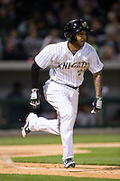 Leury Garcia (24) of the Charlotte Knights hustles down the first base line against the Scranton\Wilkes-Barre RailRiders at BB&T BallPark on May 1, 2015 in Charlotte, North Carolina.  The RailRiders defeated the Knights 5-4.  (Brian Westerholt/Four Seam Images)
