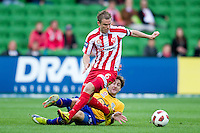 MELBOURNE, AUSTRALIA - OCTOBER 23: Matt Thompson of the Heart controls the ball during the A-League match between the Melbourne Heart and Gold Coast United at AAMI Park on October 23, 2010 in Melbourne, Australia. (Photo by Sydney Low / Asterisk Images)