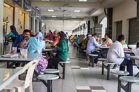 Diners Having Lunch, Individual Food Vendors on Left.  Ipoh, Malaysia.