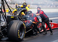 Aug 9, 2020; Clermont, Indiana, USA; Crew member Dom Lagana (left) helps push the dragster of NHRA top fuel driver Billy Torrence during the Indy Nationals at Lucas Oil Raceway. Mandatory Credit: Mark J. Rebilas-USA TODAY Sports