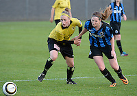 20140502 - VARSENARE , BELGIUM : Lierse's Caroline Berrens (l) pictured with Brugge's Anne-Lore Scherrens (r) during the soccer match between the women teams of Club Brugge Vrouwen  and WD Lierse SK  , on the 26th matchday of the BeNeleague competition on Friday 2 May 2014 in Varsenare .  PHOTO DAVID CATRY